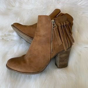 Call it Spring tassel booties